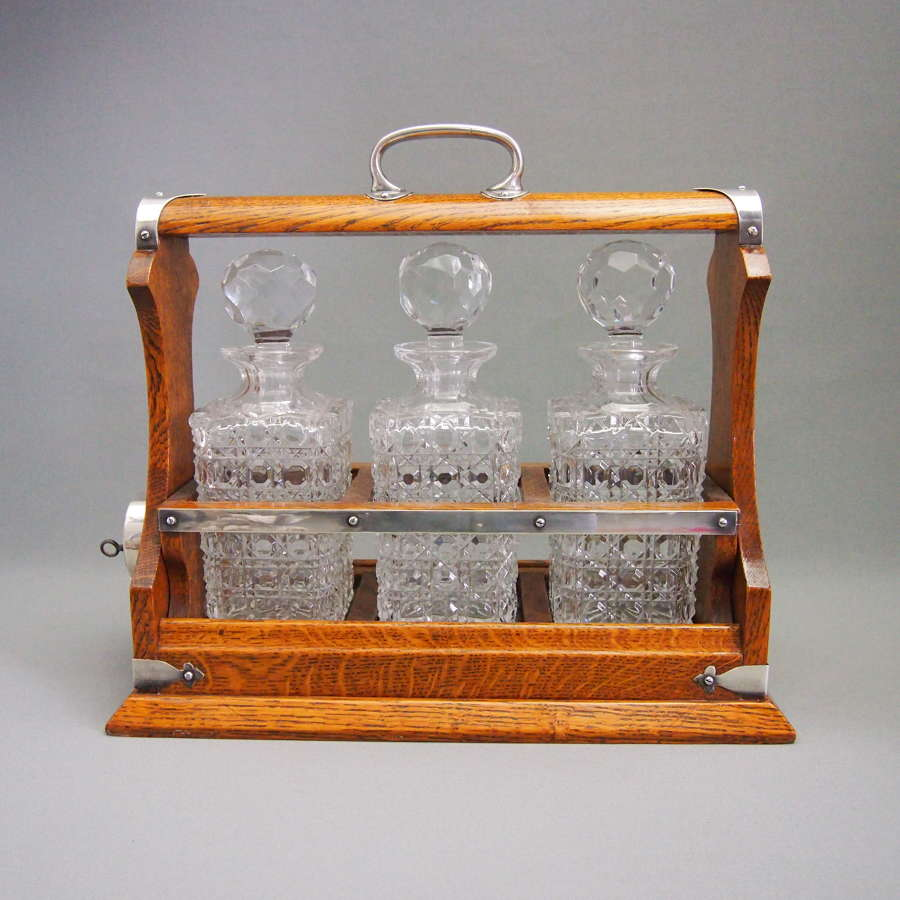 Oak and Plated 3 Decanter Tantalus c1910