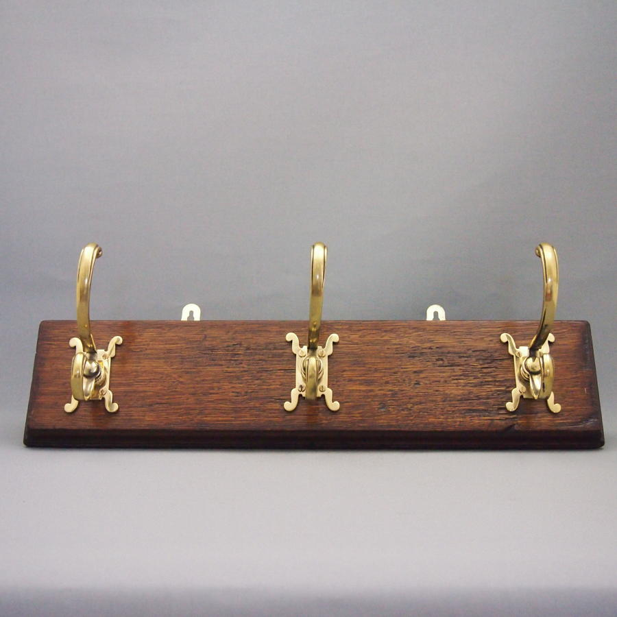Brass Coat Hook Set on Oak Base