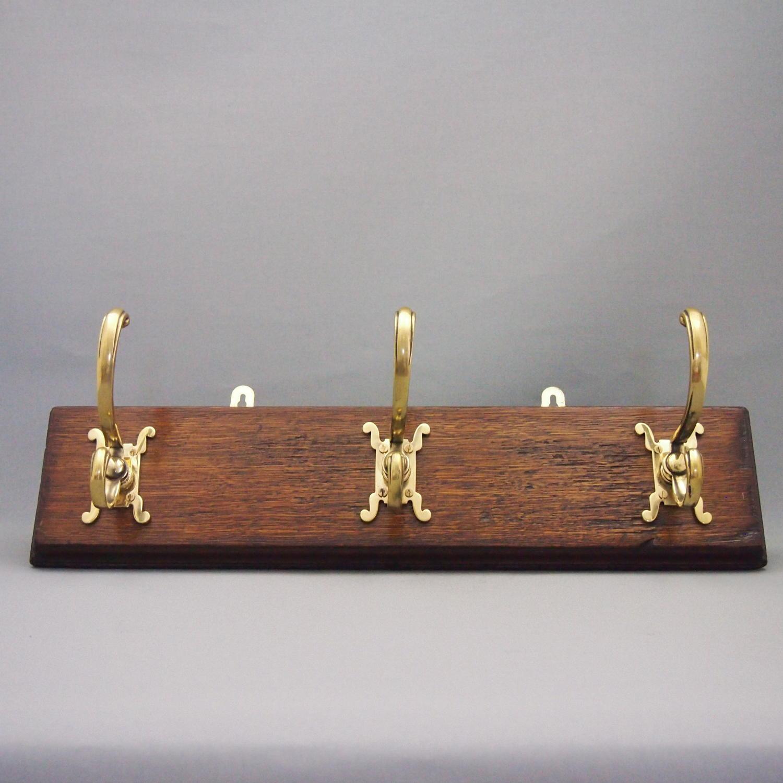 Brass Coat Hook Set on Oak Base