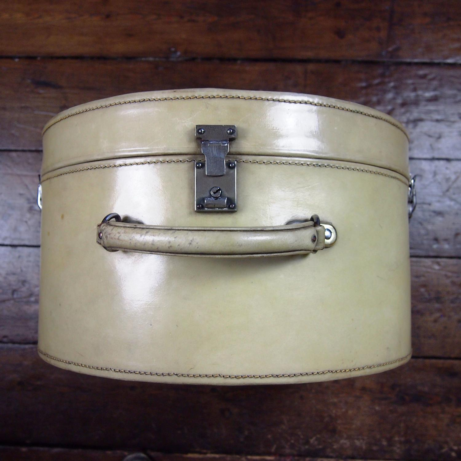 Vellum Shaped Hat Box with Deco Chrome Locks.