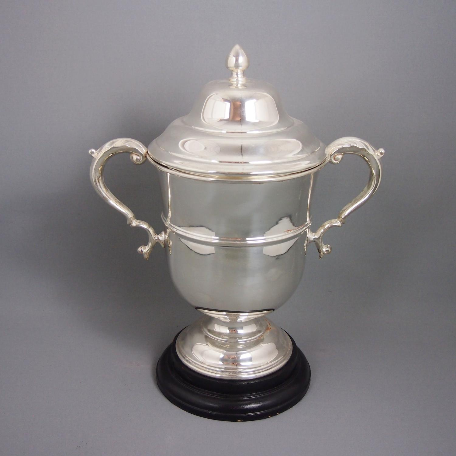 Silver Plated Vintage Trophy on wooden stand.