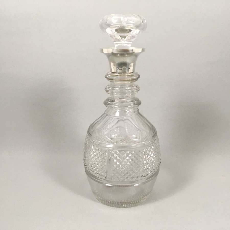 Antique cut glass silver rimmed Decanter. W8498