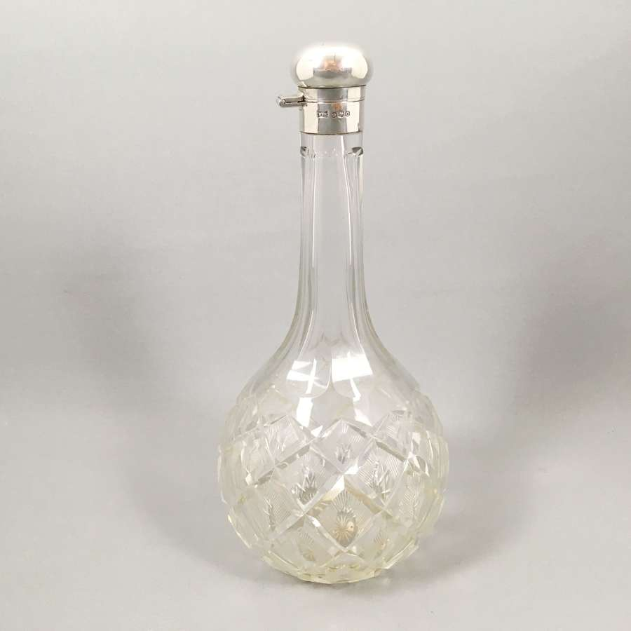Vintage silver topped cut globe decanter. W8499