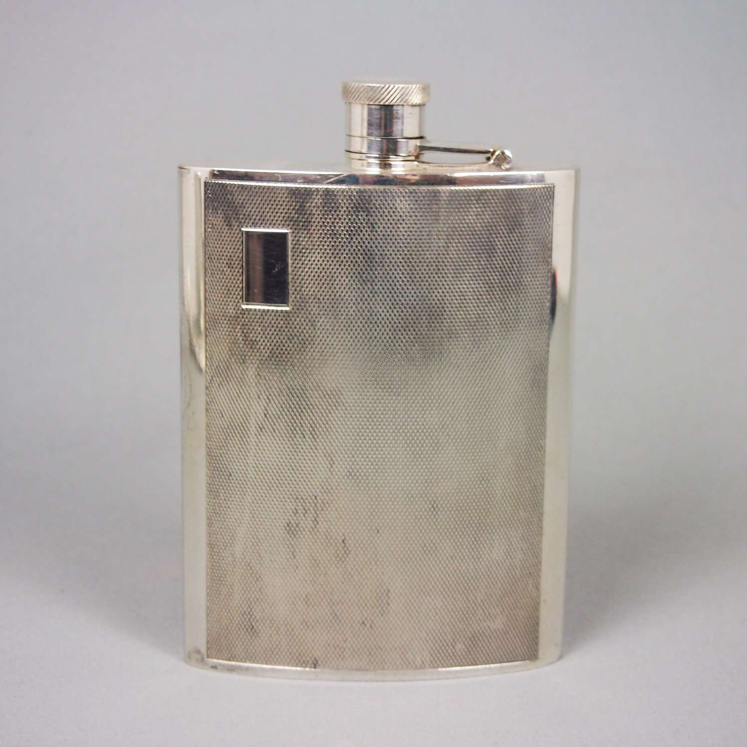 Vintage engine turned silver plated whisky flask. W8503
