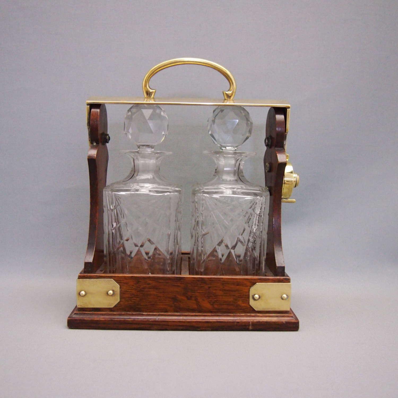 Two Bottle Oak & Brass Antique Tantalus. W8587