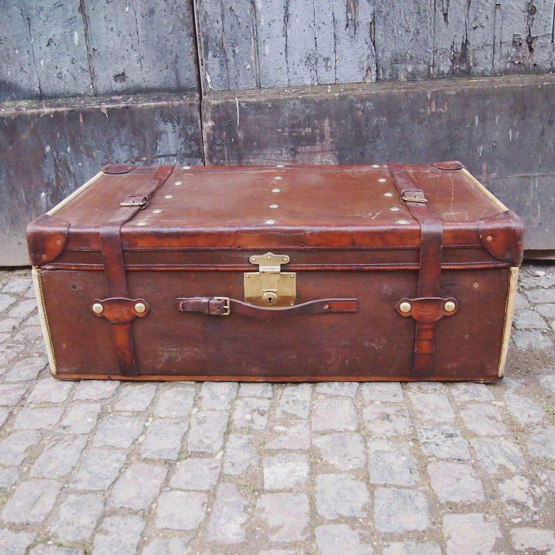 Antique Finnegan Canvas Leather & Vellum Studded Trunk. W8654