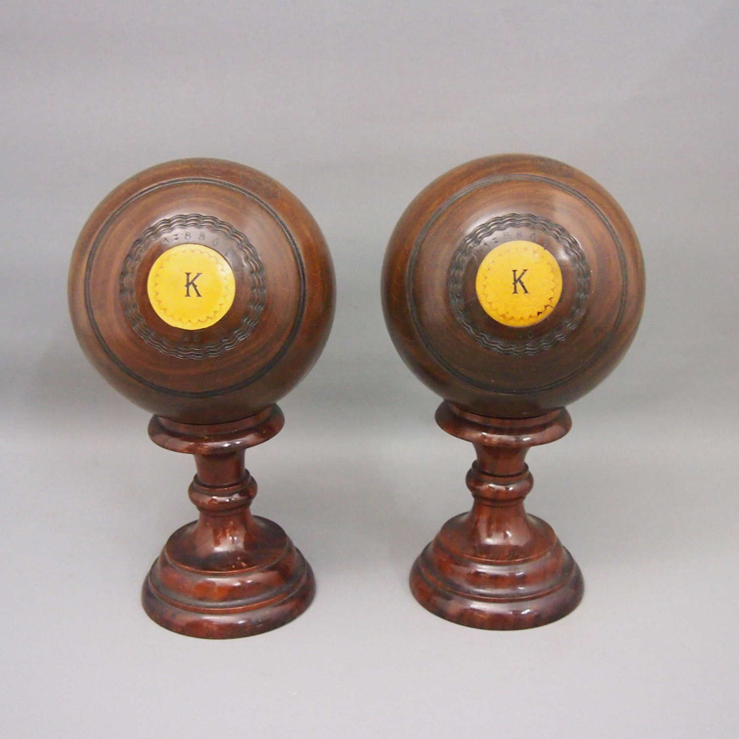 Pair of Antique Wood Bowling Balls on Turned Stands. W8656